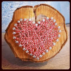 String heART on a slice of our plum tree that we - unfortunately - had to remove. Our son was busy hammering the nails (which belonged to his great-grandfather) and wrapping the yarn so this made the perfect gift for my hubby's birthday .