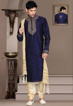 Navy blue art silk readymade kurta Enhanced with zari and resham work Beige art silk churidar is available with this Dupatta and mojari shown in the image is for photography purpose. (Slight color variation is possible.)