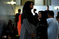 Relatives of victims of human trafficking wait for the sentence after an army general, two provincial politicians and police officers were among the 46 people held guilty in a court in Bangkok, Thailand, July 19, 2017.