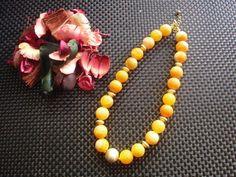 Elegante Kette in Achat gelb 16 mm, Zwischenteile vergoldet und gebürstet