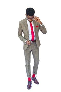 Burst of color! But suit pants shouldn't be rolled up. Too much. The red socks will show when oh sit