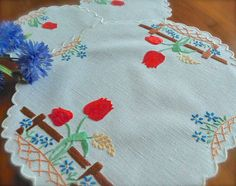 Check out this item in my Etsy shop https://www.etsy.com/uk/listing/498272265/hand-embroidered-tulips-vintage-linen