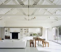 White ceiling beams, wood and windows