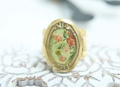 Vintage style ring jewelry filigree and photo locket pink rose print on green background, adjustable ring, raw brass antique style gold tone by OretaVintage on Etsy