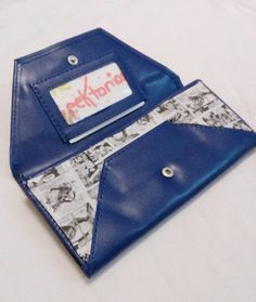 Hey, I found this really awesome Etsy listing at https://www.etsy.com/listing/184483468/comic-book-clutch-handbag geek chic office look