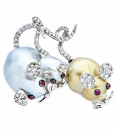 Cultured Pearl, Diamond and 18K White Gold Mice Brooch Of whimsical motif, the three little mice with cultured pearl bodies, diamond ears and tails, ruby eyes, mounted in 18k white gold - See more at: https://dupuis.ca/upcoming-sales-results/?item=25513&auctionid=74#sthash.ZnkWugpA.dpuf