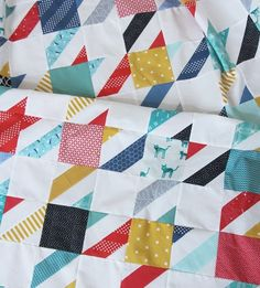 Scrappy Houndstooth from Cluck Cluck Sew, she links the tutorial that she used from youtube...Quilting Made Easy.