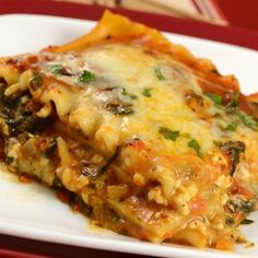 An easy vegetarian lasagna is filled with spinach and ricotta cheese and has a topping of mozzarella and Parmesan. Lasagne Recipes, Pasta Recipes, Cooking Recipes, Yummy Recipes, Yummy Food, Bulk Cooking, Dinner Recipes, Freezer Recipes, Batch Cooking