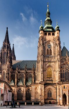Glory ― A person standing in one of the archways gives some idea as to the masive scale of the glorious Saint Vitus' Cathedral. Saint Vitus' Cathedral is a Roman Catholic cathedral, and the seat of the Archbishop of Prague. Located within Prague Castle and containing the tombs of many Bohemian kings and Holy Roman Emperors, this cathedral is an excellent example of Gothic architecture and is the biggest and most important church in the country.   #Prague #Saint_Vitus_Church #John_and_Tina_Reid