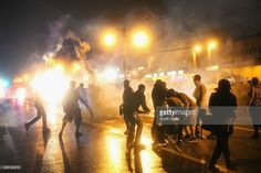 Police fire tear gas at demonstrators protesting the shooting of Michael Brown after they refused to honor the midnight curfew on August 17, 2014 in Ferguson, Missouri. The curfew was imposed on Saturday in an attempt to reign in the violence that has erupted nearly every night in the suburban St. Louis town since the shooting death of teenager Michael Brown by a Ferguson police officer on August 9.