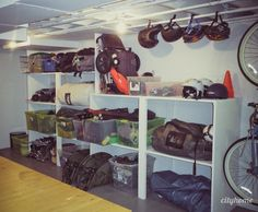 Organized gear in a garage. My husband needs this....REAL BAD!