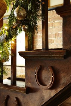 Detail of horse shoes on staircase- holiday decor at the Polohouse. Midwest Living Magazine polohouse.blogspot.com  equestrian decorating  #equestrian
