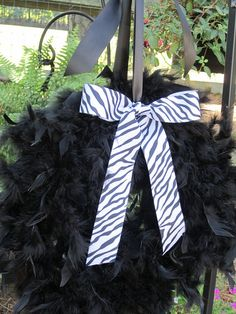 Unique Animal print Feather Wreath. Zebra and Giraffe ribbon available :) Made by the fabulous @Ashlyn Lafone