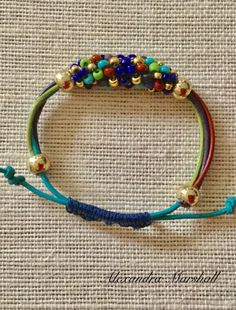 Custom made for Terri: Multicolored leather and Peyote beaded tube bracelet with adjustable sliding knot closure by Alexandra Marshall. #B2613.