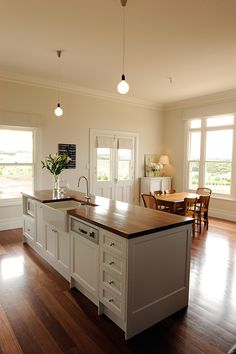 I have the same cabinetry now though with a Caesarstone benchtop... love to try the polished wood.