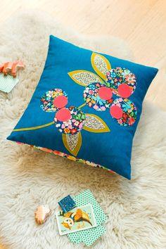 Fleur je bank op met vrolijke zelfgemaakte kussens