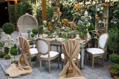 Distressed antique mirrored table with natural Alice Pop chairs and natural confessional chairs from Luxe Event Rentals make up this spread featured in the June edition of Grace Ormonde Wedding Style.