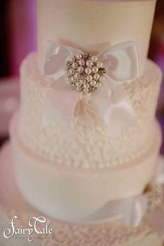 pearl brooch and all white cake  wedding at www.NortheastWeddingChapel.com