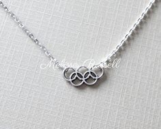 A personal favorite from my Etsy shop https://www.etsy.com/listing/105596825/olympic-rings-silver-necklace-rio-2016