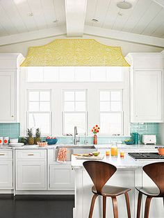 Love everything about this kitchen, the cabinets, the aqua backsplash, the pop of yellow  of course that gorgeous sink.