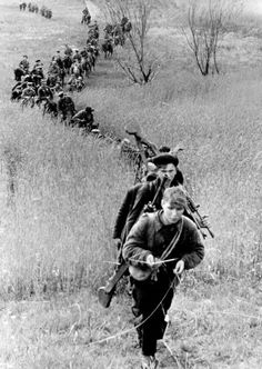 Partisan unit moving through the Leningrad Oblast. #WWII