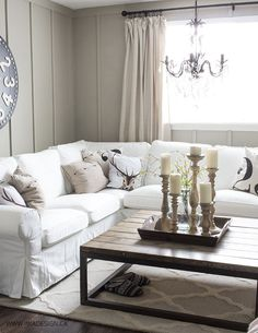 White Slipcovered Sectional Oversize Clock Board And Batten Wall Chandelier Large Coffee Table