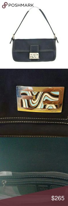 """Fendi  """"Ocean Wave"""" Enamel Buckle Blue Wristlet Perfect for a night out!  FENDI - featuring a blue baguette handbag.  Description- a navy blue canvas exterior with contrasting white stitching, single shoulder strap with buckle details at both ends, top flap closure with FF 'ocean wave' enamel filled logo buckle fastening. Measuring 4 by 14 by 26.5cms. Bag is in very good overall condition. There may be some fine scratches to the metal hardware. The interior lining is slightly dusty from use…"""