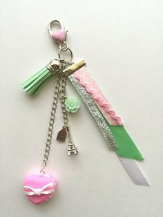 ♥ Planner / Bag Charm ♥   This pretty, silver tone dangle charm, is handmade, and features a tassel, flower, eiffel tower, macaron and ribbon