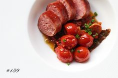 Delicious Tapas: Salsiccia with braised tomatoes & garlic #159