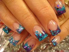 Holographic glitter nails with purple tips.