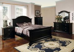 5 pc newville collection black finish wood queen bed set with paneled look headboard and footboard with turned ball feet this set includes the queen bed