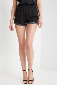 Details Chiffon shorts feature elasticized waist band and side stitch detail along the sides complete with studding detail. Fully lined. Content & Care • S: