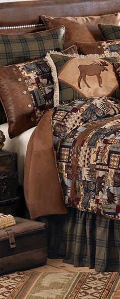 Woodland Cabin Bedding:Patchwork wildlife scenes in wine, navy, forest green and browns are woven in a cotton/poly tapestry complemented by brown faux suede, olive and black plaid and antique brass rivets to create this inviting lodge bedding. Lodge Look, Lodge Style, Rustic Cabin Decor, Country Decor, Scandinavian Modern, Woodland Lodges, Moose Decor, Rustic Bedding, Log Cabin Homes