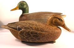 VINTAGE PAIR OF WORKING MALLARD DECOYS. I was very much attracted to this lovely pair of birds not only for their impressive carving details but for their exceptional, real life paint that separates them from the crowd.  Each measures about 17 inches. Found in Maine. Ca. 1940.   $ 1250.