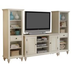 Entertainment credenza with two complementing cabinets and hidden cable access points. Product: 3 Piece entertainment center se...