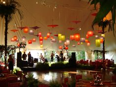 Multicolor paper lanterns and parasols hanging over reception dance floor.  Image courtesy of Doc Waldrop at Full Circle Lighting & Productions.