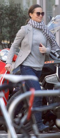 Pippa Middleton was literally running her errands this morning as she jogged through the streets of Chelsea in a grey blazer and knee-high boots