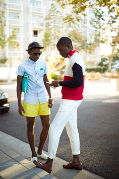 White pants and block  color sweaters yellow shorts