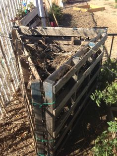 Tight on space for your compost bin?  Try this three sided pallet hinged on the front for easy opening.  We put this in our garden for all the tomatoes we just harvested and found using three sides works great.  We can add all the ingredients from the top and open it to turn it as needed.  We put the pallets on their sides but you could also use them with the high side up to store more if you need it.