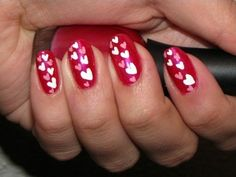 Valentines nail design in Red shades with hearts
