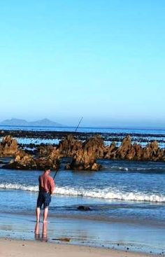Fishing from the beach in Pringle Bay. When you stay at Dreams you only need 3 minutes walk to your fishing. www.daydreams.co.za