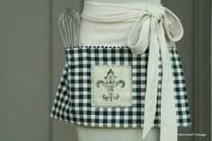 Several fun, vintage looking aprons on this site