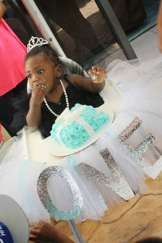 Breakfast at Tiffany's First Birthday | Tiffany's box Smash cake and high chair tutu  Smash cake made by @madelina  Photographed by @AmandaPhotos30