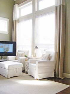 Great idea for window treatments in those pesky two-story living rooms in suburban Atlanta
