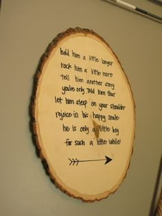Adorable poem about a little boy written on a rustic wood round log sign. This is perfect decor for baby boy woodland nursery theme! It would also make a great baby shower gift. The little boy poem is hand printed on the wood log sign and there is an arrow at the bottom. Little Boy Poem - Hold him a little longer Rock him a little more Tell him another story Youve only told him 4 Let him sleep on your shoulder Rejoice in his happy smile He is only a little boy for such a little while Size…