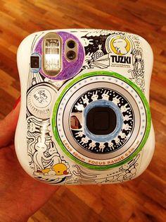 A hand-drawn Tuzki edition Fujifilm instax mini by Tuzki's creator, Momo Wang.