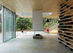 Sliding glass facade at D House in Brittany by French firm Lode Architecture