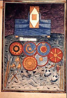 """insigne du Magister officiorum ou Maitre des offices, haut fonctionnaire qui contrôlait  l'ensemble de l'administration du IV°s au XI°s La """"NOTICIA DIGNITATUM"""", sorte d'annuaire du début de la Gaule mérovingienne conservé à la cathédrale de Spire, en Rhénanie, est illustrée de scènes caractéristiques de l'époque. L'original a malheureusement disparu et il s'agit ici d'une copie du XV°s dont la miniature représente une fabrique de boucliers, casques et armures"""