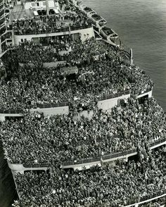 """The liner """"Queen Elizabeth"""" bringing American troops into NY Harbor at the end of WWII, 1945."""