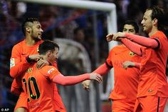 Neymar (left) and Ivan Rakitic (right) join Messi in celebration of his 31st minute spot-kick
